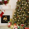 Christmas tree with presents and fireplace with stockings --- Image by © Royalty-Free/Corbis